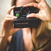 Christina with vintage Polaroid camera